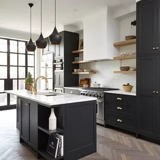 kitchen black cabinets mats target 75 most popular transitional with design designs example of a medium tone wood floor in toronto