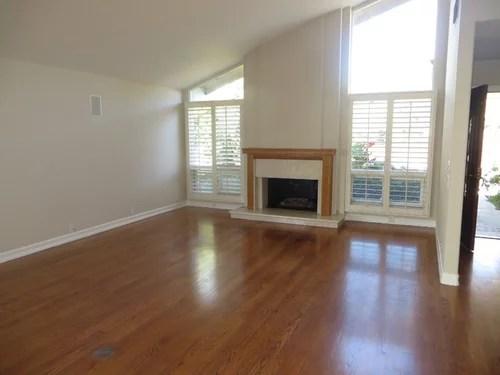 Should I stain golden oak hard wood floor a dark walnut shade