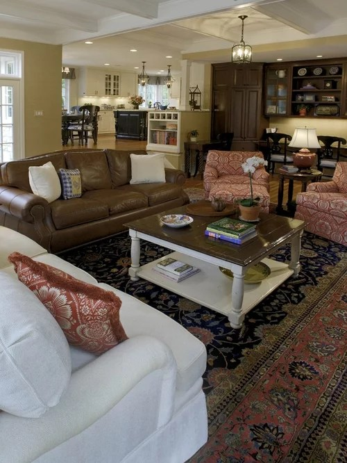 mixing leather and fabric furniture in living room warm paint colors | houzz