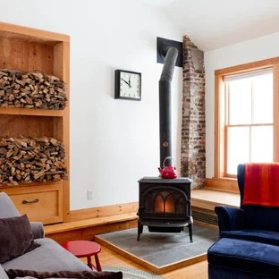 living room designs with wood stove decorating navy blue sofa hearth houzz example of an eclectic medium tone floor design in new york white