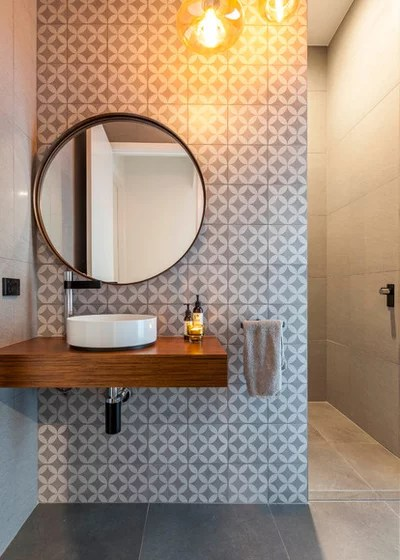 Contemporary Powder Room by PM Concepts