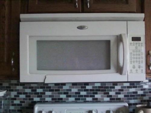 over the range microwave door cracked