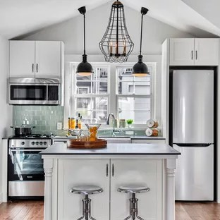small apartment kitchen ideas metal table kitchens houzz transitional photo in vancouver with green backsplash and an