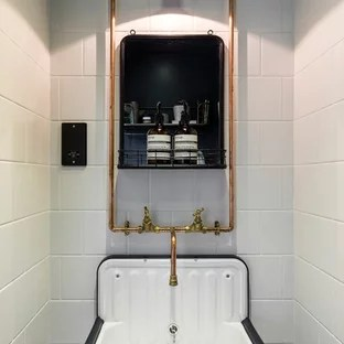 small scandinavian cloakroom in london with white tiles white walls and a wall mounted