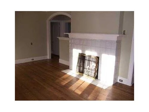this ugly white tile fireplace needs to