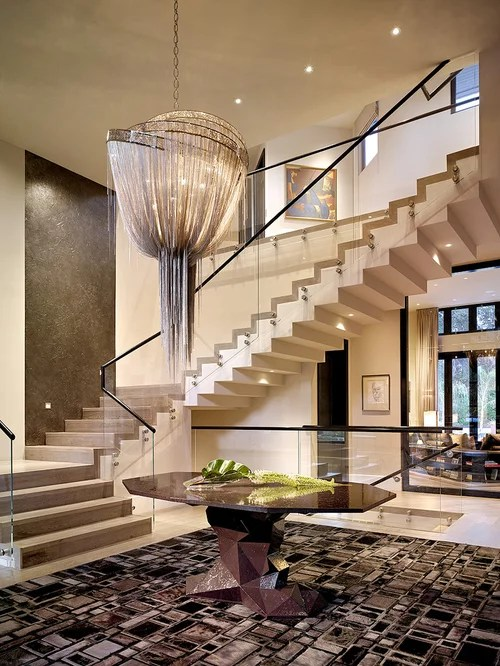 Example Of A Large Trendy Foyer Design In London With Beige Walls
