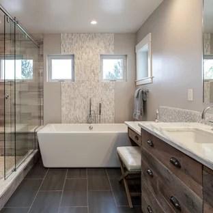 beige tile bathroom with gray walls