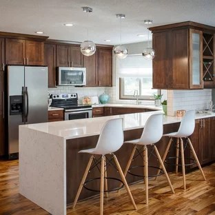 75 Beautiful Kitchen With Brown Cabinets And White Backsplash Pictures Ideas January 2021 Houzz