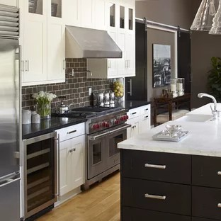 marble countertops and brown backsplash