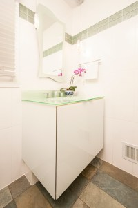 Contemporary Powder Room with Glass Vanity Cabinet