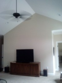How to decorate a wall in a vaulted ceiling room.