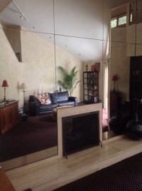 Do I remove a mirrored wall in my living room?