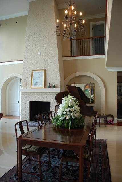 Grand Painted Brick Fireplace Modern Dining Room