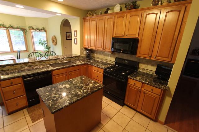 kitchen cabinet liner kohler cast iron sink brown quartz countertop with beige tile backsplash ...