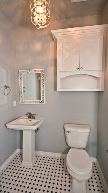 White Half Bath with Black and White Tile Floor