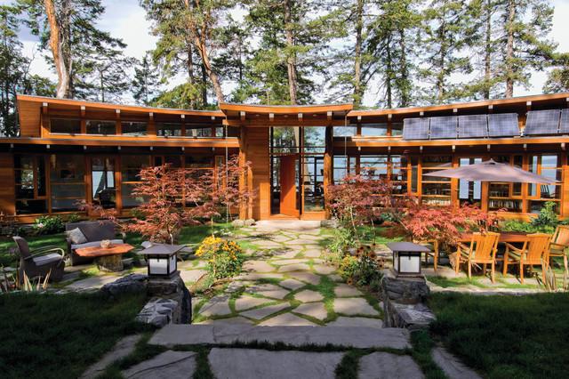 Booklovers House | Axial View from Entry Across Garden contemporary-exterior