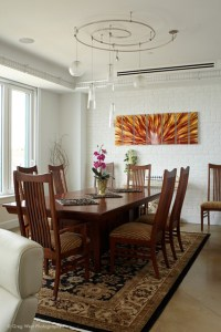 Custom track lighting accents the dining space ...