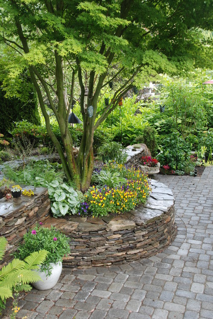 stacked stone walls and paver patio