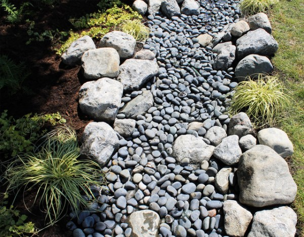 water and stone dry riverbed garden