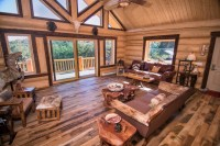 Log home with mushroom wood trim accent and skip-planed ...