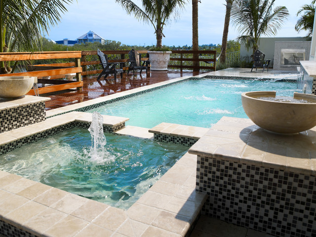 Luxury Pool Area by Alvarez Homes  Home Builders in Tampa Florida  Tropical  Pool  Tampa