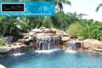 Tropical backyard with full flagstone deck - Tropical ...