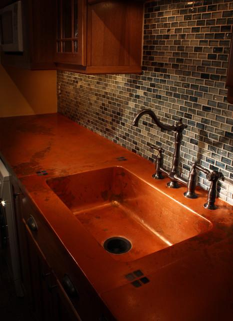 copper kitchen faucets corner hutch richmond va concrete countertop