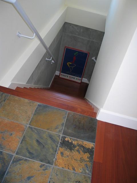 Slate Landing Wood Stairs Custom Railing to Basement