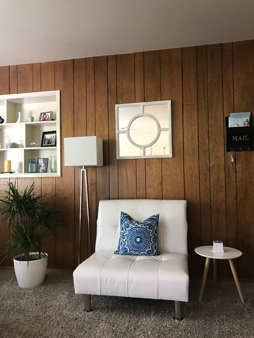 Ugly 70s wood paneling in our outdated apartment