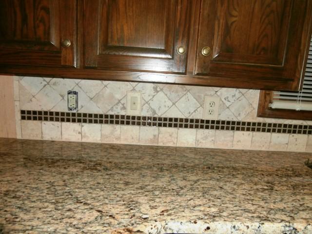 ST CECILIA Granite on Dark Cabinets  Traditional