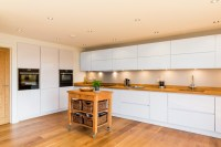 Nobilia White High Gloss Kitchen with Solid wood worktop ...
