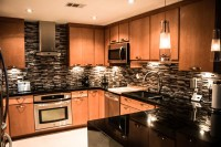 Maple kitchen cabinets with black absolute granite countertops