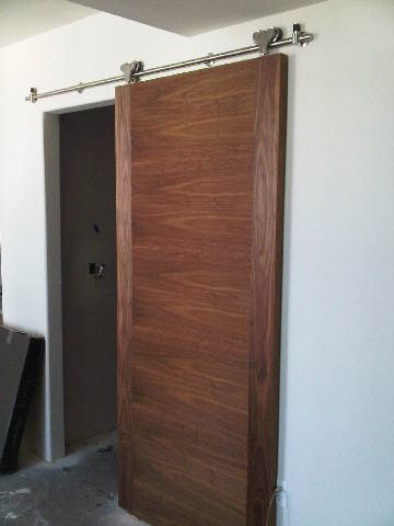 modern living room track lighting brown leather couch decorating ideas custom walnut barn door w/ - contemporary ...