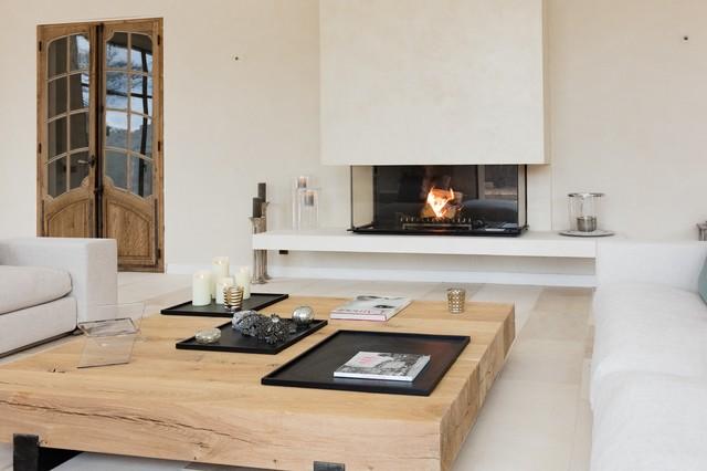 Chemine foyer contemporaine  design avec vitre escamotable Sole en pierre  Contemporain