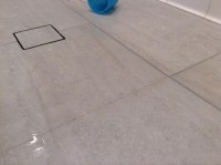 Ugh, new tile shower not draining--puddles