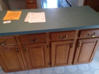 What color walls? Oak cabinets and blue/green countertops