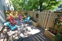 Townhouse patio with fence, benches and planter boxes ...