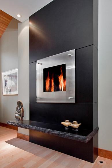Black Granite Monolithic Fireplace  Modern  Living Room  Portland Maine  by Morningstar