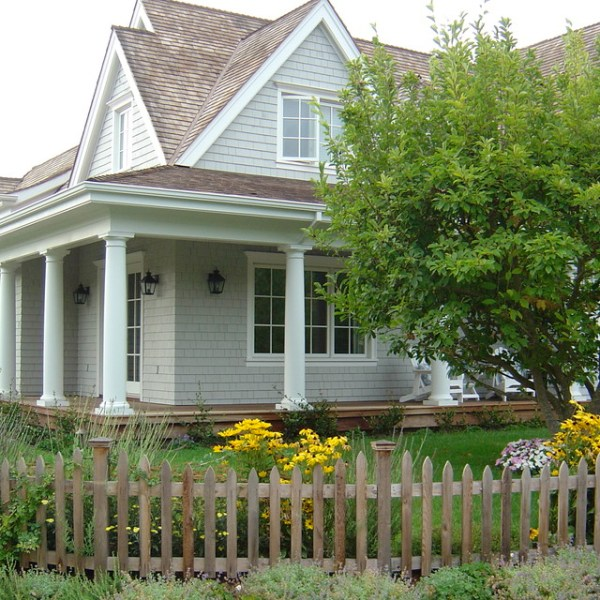 cape home with perennial bed
