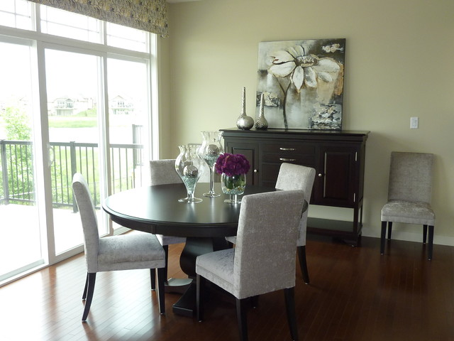 round wooden kitchen table cabinet installers dining room in model home - modern ...