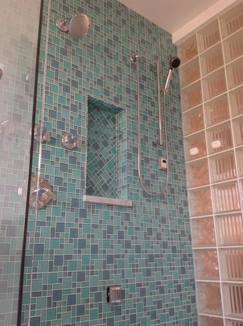 Herringbone glass tile shampoo niche with Argus pattern glass block shower wall  Beach Style