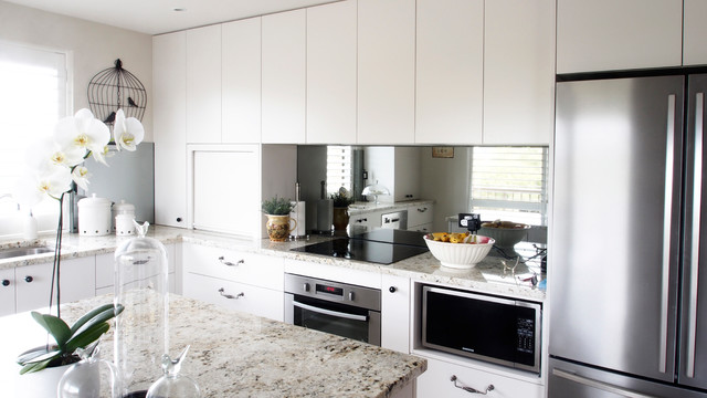kitchen mirrors average size of sink 4 ways to add storage in your home office behind the cooking zone image above mirror is placed and below wall cabinetry this brightens up counter space