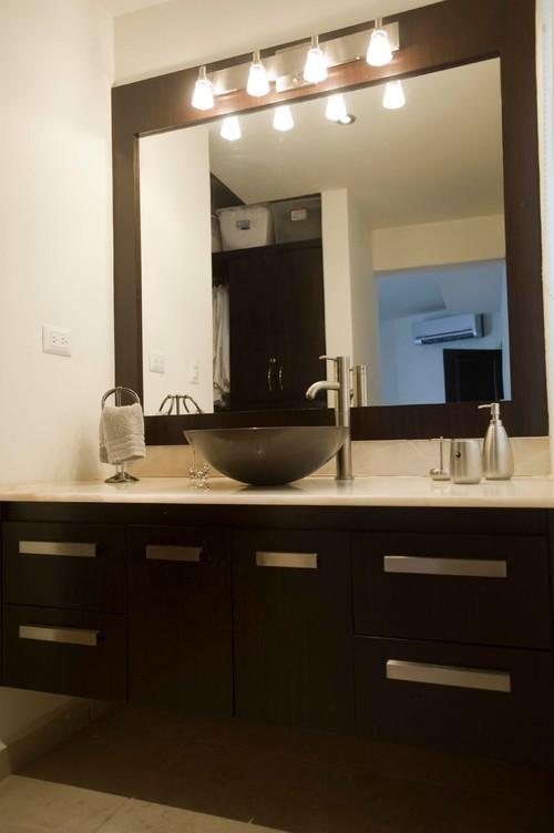 vanity, mirror and light fixture