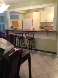 Entry into condo, open window kitchen