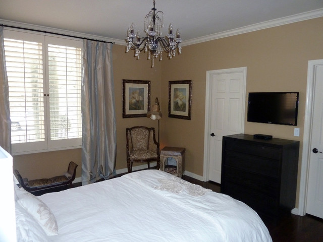 Guest Suite With Tv Mounted On Wall Over Small Dresser Contemporary Bedroom