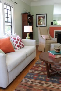 Coral Fireplace, Kilim Rug and Ikat Pillow with Wingback ...