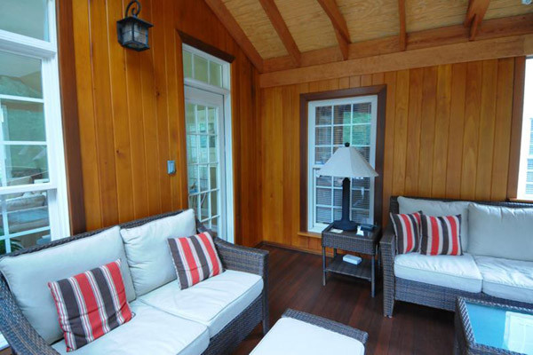 Interior walls of screen porch finished in cedar