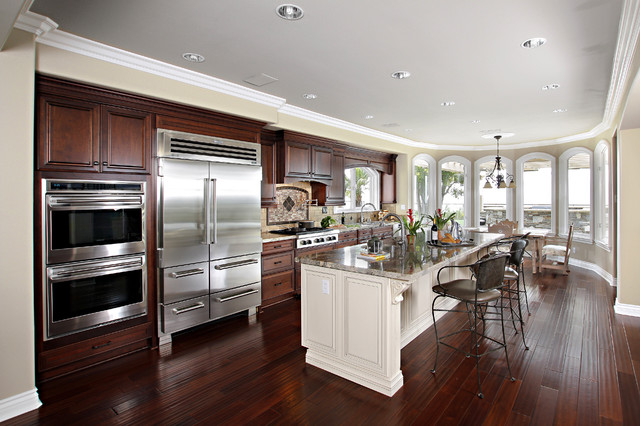 stainless steel wall panels kitchen commercial floor for dark cabinets with white island in laguna niguel, ca