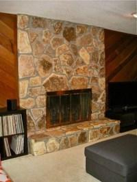 Cedar plank wall and light stone fireplace 70's house
