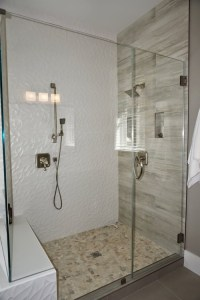 What kind of tile is in the shower walls?